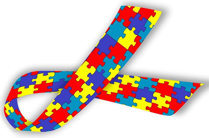 Símbolo do autismo: uma fita feita com peças de quebra-cabeças